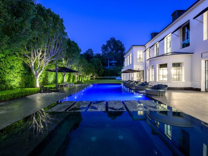 The World Class Trophy Mansion in Los Angeles is a warm contemporary French Manor set in the heart of Old Bel Air now available for sale. This home located at 10701 Bellagio Rd, Los Angeles, California; offering 8 bedrooms and 12 bathrooms with over 24,000 square feet of living spaces.