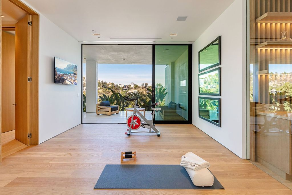 The Beverly Hills Mansion is an organic modern masterpiece set on Located on a picturesque acre featuring automated lifestyle now available for sale. This home located at 1274 Lago Vista Dr, Beverly Hills, California; offering 6 bedrooms and 8 bathrooms with over 13,000 square feet of living spaces.