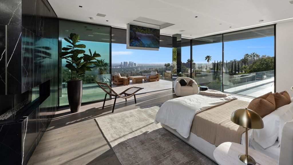 The World Class Beverly Hills Mansion is one of the most iconic architectural homes with impeccable design by SAOTA now available for sale. This home located at 1108 Wallace Rdg, Beverly Hills, California; offering 7 bedrooms and 14 bathrooms with over 18,000 square feet of living spaces.