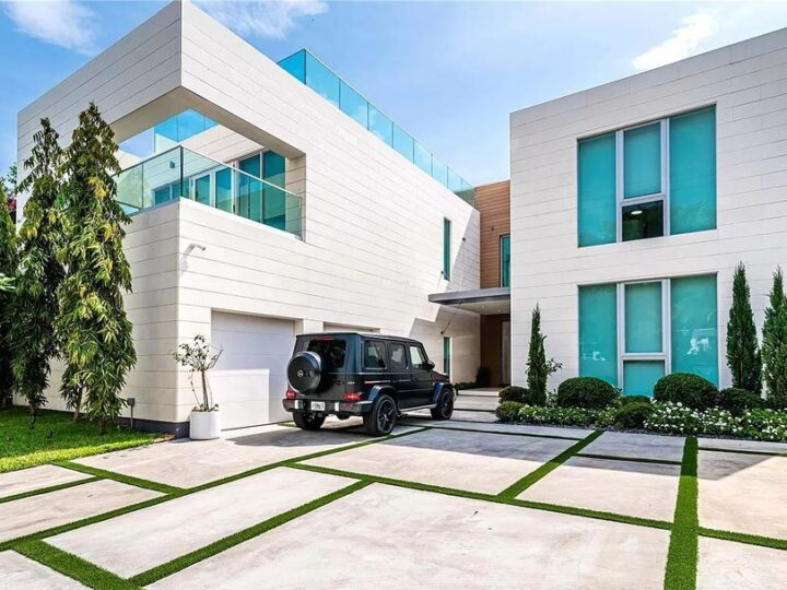 The Modern Waterfront Villa in Miami Beach is a luxurious home on Pine Tree Drive ideal for entertaining now available for sale. This home located at 5711 Pine Tree Dr, Miami Beach, Florida; offering 7 bedrooms and 9 bathrooms with over 8,000 square feet of living spaces.