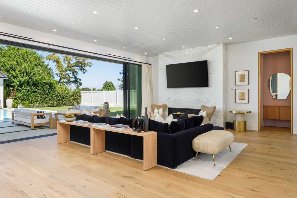 The Modern Farmhouse in Encino is a marvel at the grand scale, gorgeous fixtures, layered textures, and sleek design now available for sale. This home located at 17015 Adlon Rd, Encino, California; offering 6 bedrooms and 10 bathrooms with over 8,900 square feet of living spaces.
