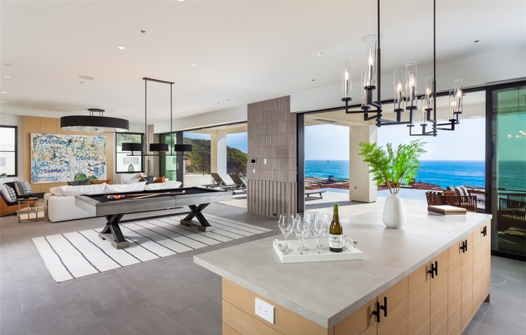 The Dana Point Home is an unparalleled custom estate redefines luxurious seaside living above the mercurial Pacific Ocean now available for sale. This home located at 17 Beach View Ave, Dana Point, California; offering 5 bedrooms and 9 bathrooms with over 8,300 square feet of living spaces.