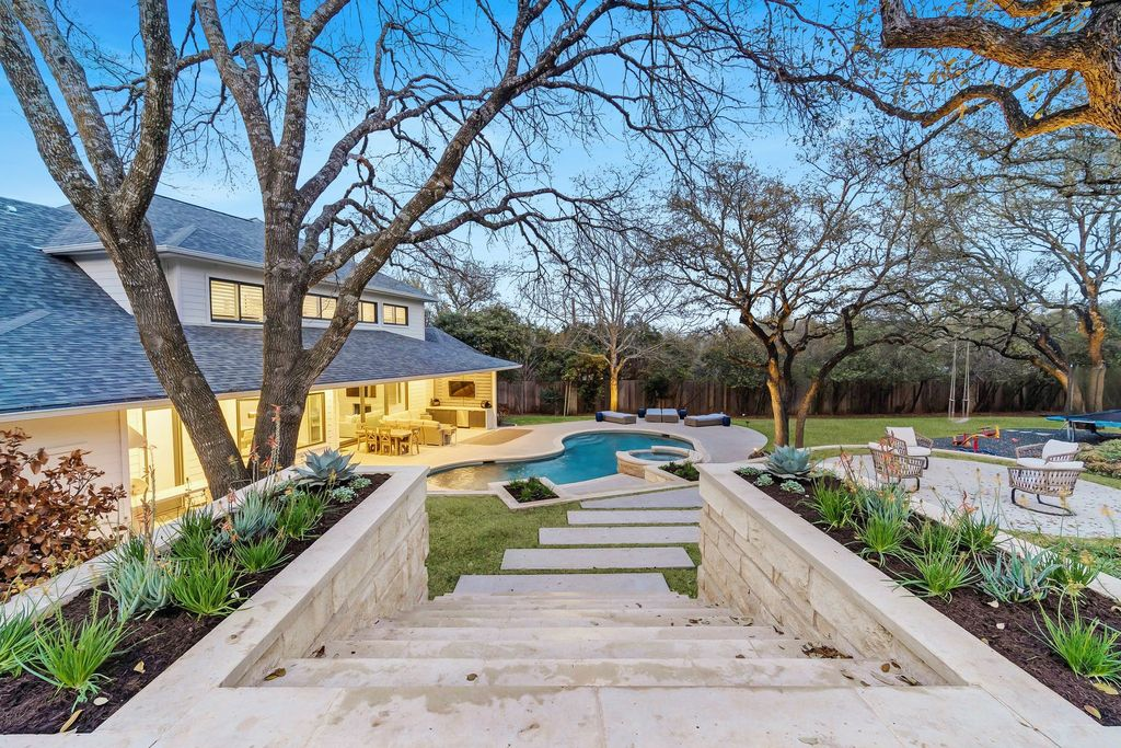 The Contemporary Farmhouse in Austin is a designer's dream with warm oak floor contrasting with light walls for a classic feel now available for sale. This home located at 5101 Cuesta Verde, Austin, Texas; offering 5 bedrooms and 6 bathrooms with over 4,700 square feet of living spaces.