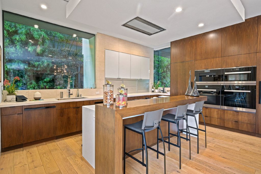 The Los Angeles Home is a modern masterpiece combines the best in sophisticated California living and naturally inspired comforts now available for sale. This home located at 11791 Chenault St, Los Angeles, California; offering 6 bedrooms and 7 bathrooms with over 7,000 square feet of living spaces.
