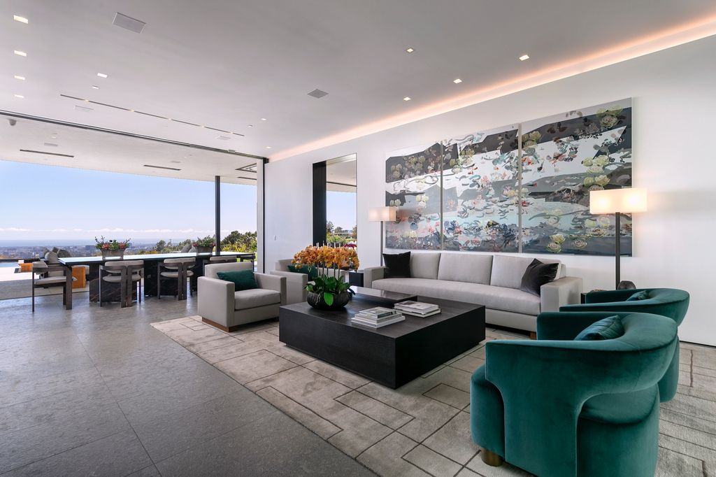 The Mansion in Beverly Hills is a spectacular hillside glass-walled sanctuary with Trousdale Estates most explosive panoramic city to ocean views now available for sale. This home located at 514 Chalette Dr, Beverly Hills, California; offering 6 bedrooms and 11 bathrooms with over 12,000 square feet of living spaces.