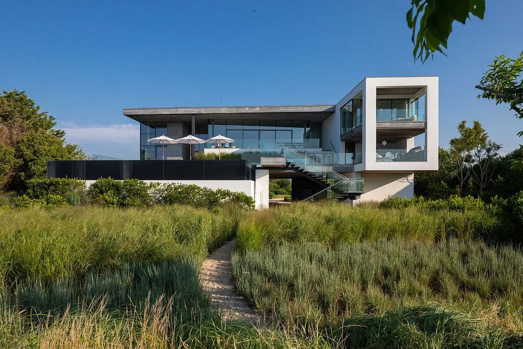 The Oceanfront Mansion in Bridgehampton located in one of the Hamptons most desirable neighborhoods, the home truly has it all now available for sale. This home located at 125 Mid Ocean Dr, Bridgehampton, New York; offering 8 bedrooms and 12 bathrooms with over 10,000 square feet of living spaces.