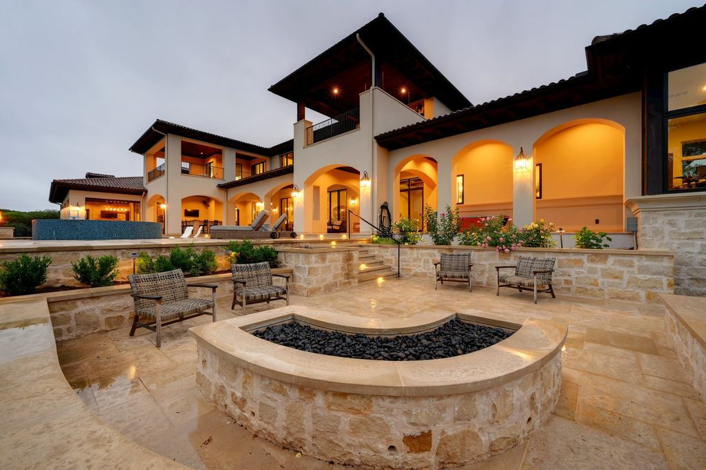 The Texas Waterfront Mansion is a spectacular residence marries quintessential Tuscany with iconic Hill Country flair now available for sale. This home located at 15201 Fm 2769, Volente, Texas