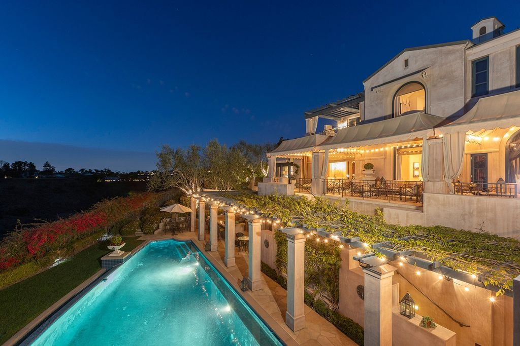 The Newport Beach Villa is an ultra-private retreat on an extraordinary oversized lot encompassing a front row span of unimpeded view now available for sale. This home located at 3 Rim Rdg, Newport Beach, California; offering 6 bedrooms and 8 bathrooms with over 11,300 square feet of living spaces.