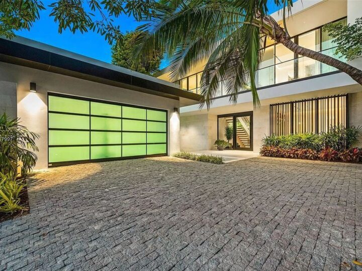 The Modern Waterfront Home in Miami Beach is a luxurious estate with panoramic views of south beach developed and built by Andian Group now available for sale. This home located at 247 E Rivo Alto Dr, Miami Beach, Florida