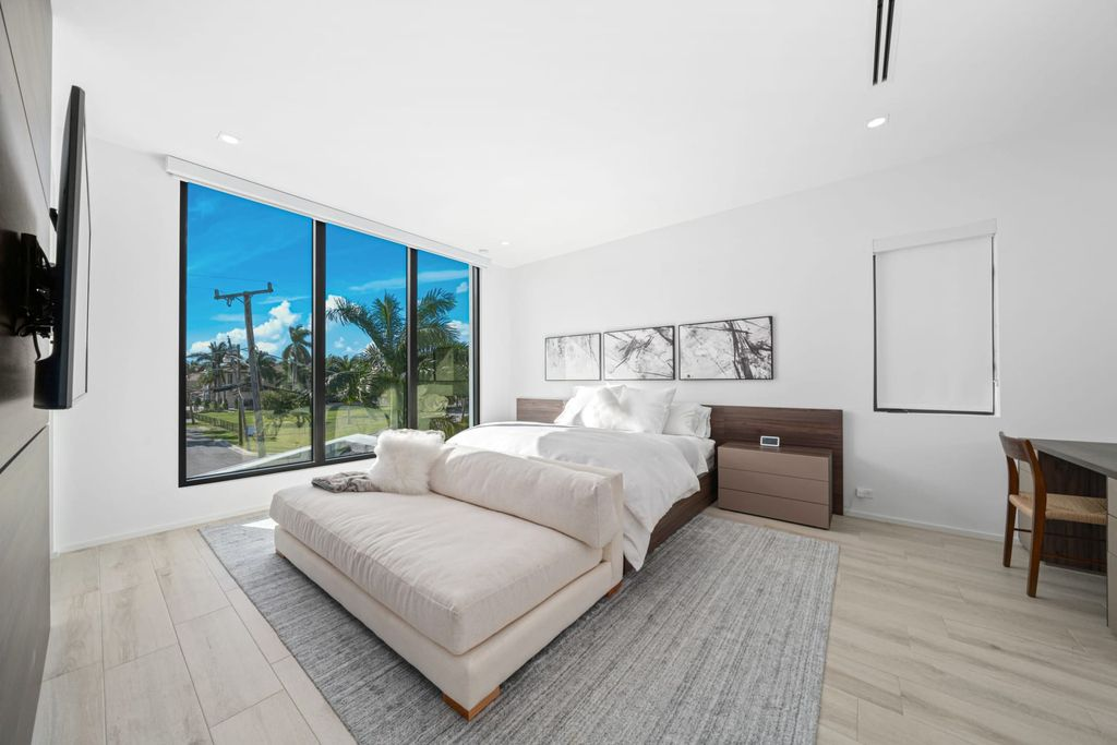 The Fort Lauderdale Home is a beautiful turnkey modern estate located on Sunset Lake with wide water views now available for sale. This home located at 2401 Solar Plaza Dr, Fort Lauderdale, Florida; offering 5 bedrooms and 7 bathrooms with over 5,400 square feet of living spaces.
