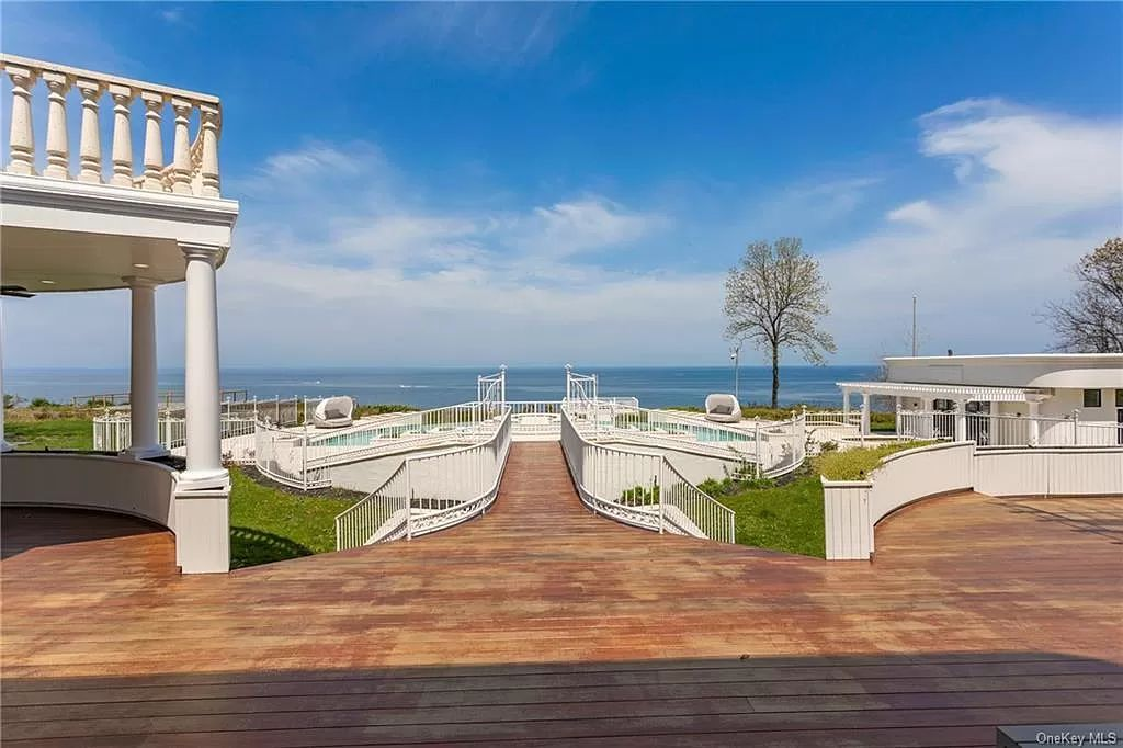 The Beachfront Home in Port Jefferson with a gated entry on 8.5 acres, boasting 310 feet of prime beach frontage now available for sale. This home located at 1 Osprey Ct, Pt Jefferson, New York; offering 11 bedrooms and 18 bathrooms with over 20,000 square feet of living spaces.