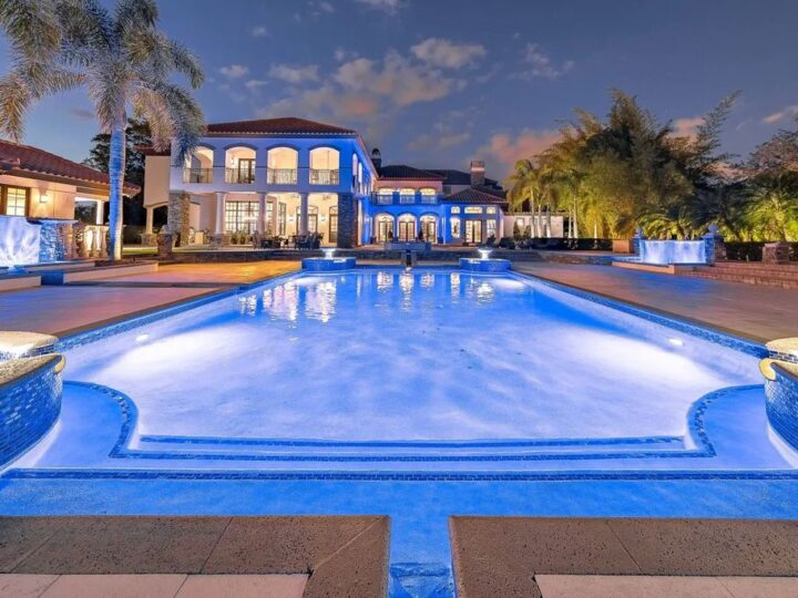 The Home in Parkland is a luxurious home with updates and Smart Home features, including a theater, custom wine cellar, saltwater pool now available for sale. This home located at 9136 NW 66th Ln, Parkland, Flordia; offering 7 bedrooms and 9 bathrooms with over 17,000 square feet of living spaces.