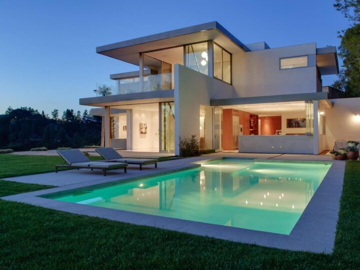 The Beverly Hills Home set atop a promontory with total privacy & unobstructed views from downtown to the ocean now available for sale. This home located at 1133 Miradero Rd, Beverly Hills, California
