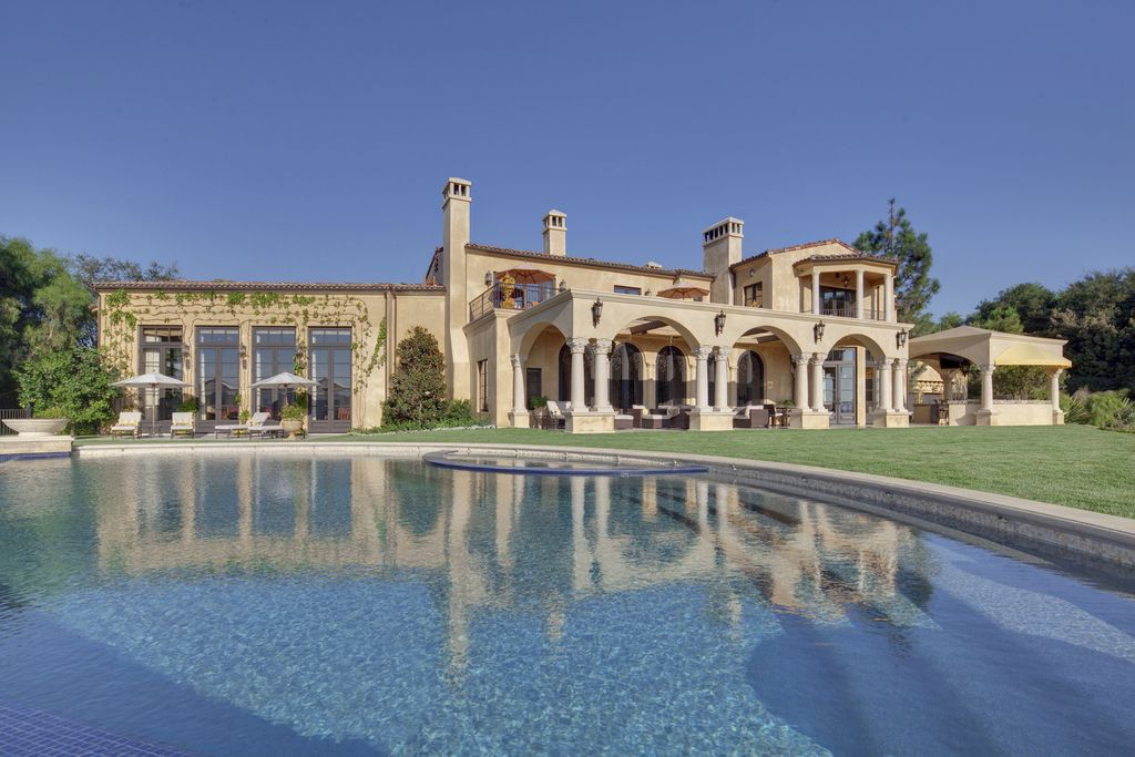 The Beverly Hills Mansion is an exquisite European Villa located within the prestigious guard-gated enclave of Beverly Ridge Estates now available for sale. This home located at 7 Beverly Ridge Ter, Beverly Hills, California; offering 6 bedrooms and 8 bathrooms with over 12,500 square feet of living spaces.