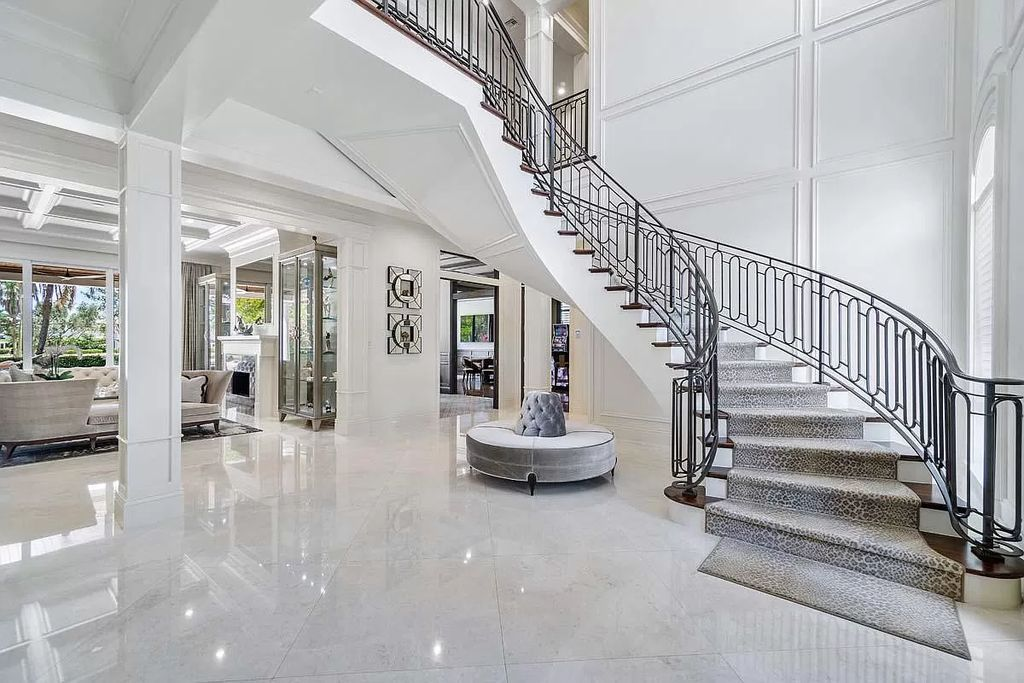 The Boca Raton Home is a luxurious estate offers an unprecedented perspective on resort-style golf course living now available for sale. This home located at 1300 Thatch Palm Dr, Boca Raton, Florida; offering 4 bedrooms and 6 bathrooms with over 6,000 square feet of living spaces.