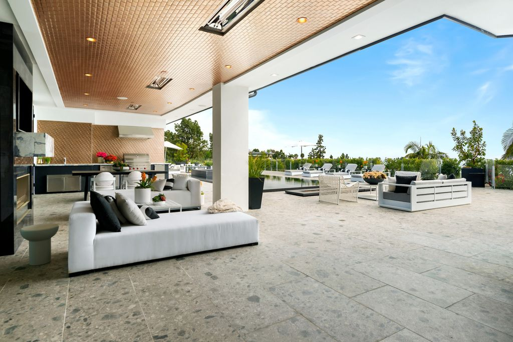 The Beverly Hills Home is a world class Trousdale Estates compound designed to elevate the art of living and entertaining now available for sale. This home located at 535 Chalette Dr, Beverly Hills, California