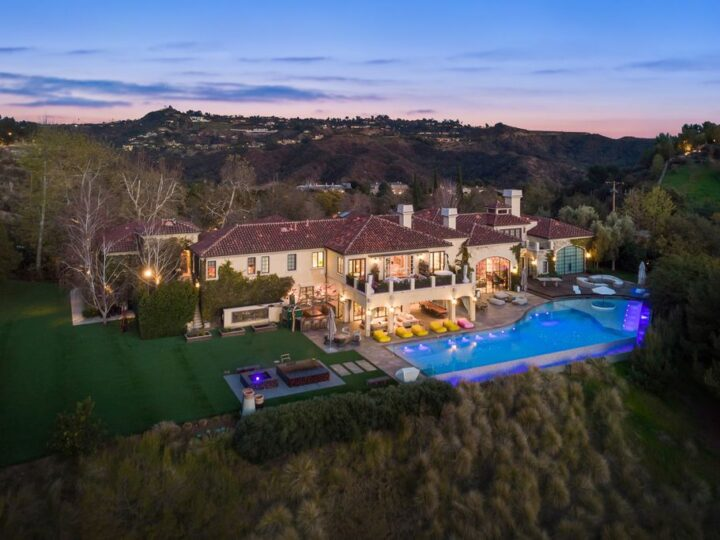 The Beverly Hills Mansion is a World class compound with stunning panoramic views set in guard gated Bella Vista Estates now available for sale. This home located at 2505 Summitridge Dr, Beverly Hills, California