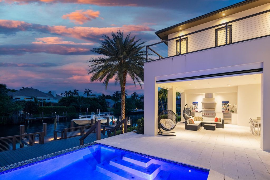 The Home in Palm Beach Gardens is a waterfront contemporary estate located in Frenchman's Creek with 155 feet of deep waterfront now available for sale. This home located at 13843 Le Bateau Isle, Palm Beach Gardens, Florida