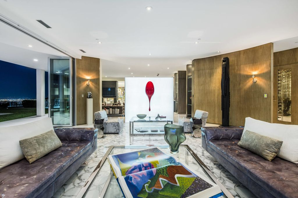 The Mid-century Contemporary Home in Beverly Hills situated on a prime city view rim lot in prestigious Trousdale Estates now available for sale. This home located at 1790 Carla Rdg, Beverly Hills, California