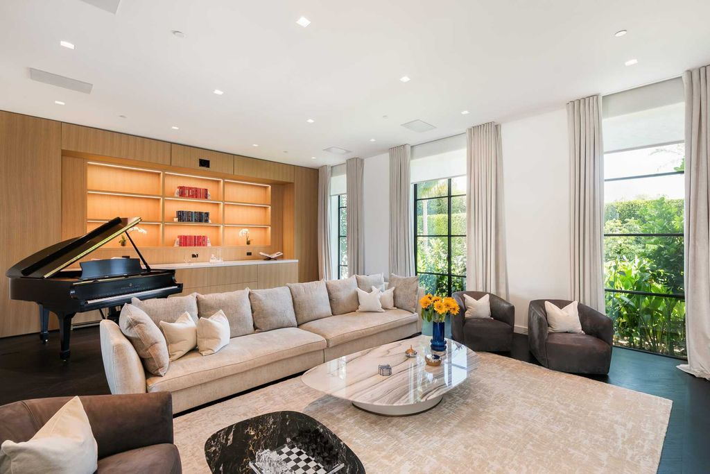 The Contemporary Mansion in Santa Monica is an extraordinary estate with  magnificent fairway and mountain views and exceptional amenities now available for sale. This home located at 1525 San Vicente Blvd, Santa Monica, California