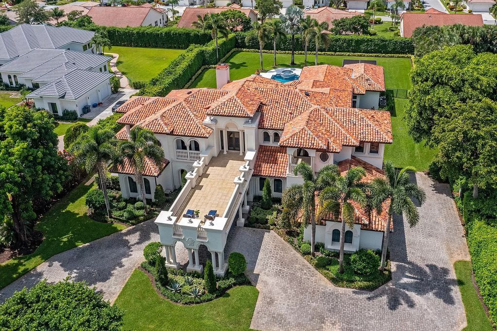 The Home in Boca Raton is a transitionally reimagined and uniquely pristine one+ acre estate in the private gated community now available for sale. This home located at 18350 Long Lake Dr, Boca Raton, Florida