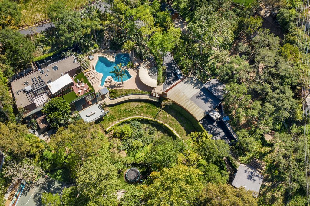 The Beverly Hills Home is a architectural compound sits behind gates on 2.38 acres on the famed Mulholland corridor now available for sale. This home located at 12835 Mulholland Dr, Beverly Hills, California