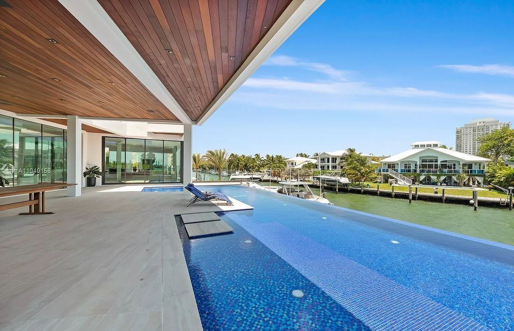 The Home in Miami is a brand new luxury modern estate with stunning bay views and over 100 feet of linear waterfront now available for sale. This home located at 1133 Belle Meade Island Dr, Miami, Florida