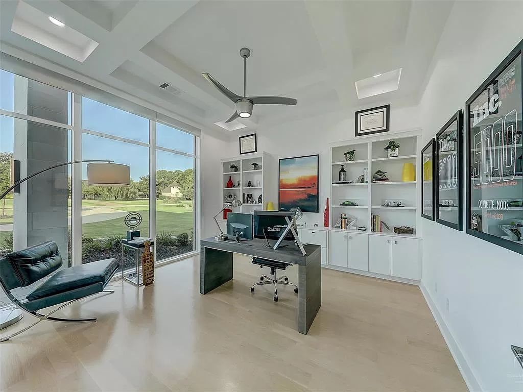 The Texas Modern Home is a light and bright home is designed for entertaining with soaring 2 story ceiling & floating staircase now available for sale. This home located at 8605 Amen Cor, Flower Mound, Texas
