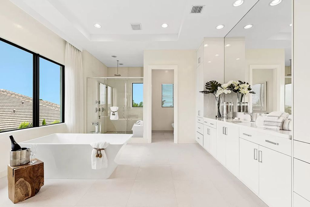 The Boca Raton Home is a Contemporary estate on a magnificent point pie lot with spectacular lake view in Boca Bridges now available for sale. This home located at 17230 Brulee Breeze Way, Boca Raton, Florida
