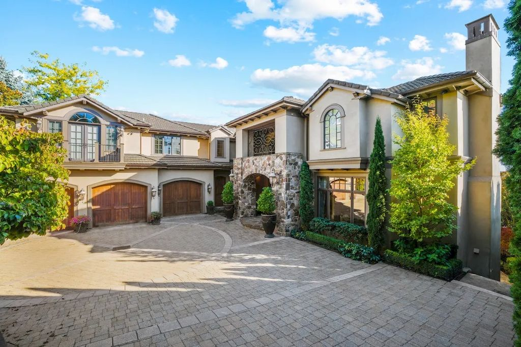 The Magnificent Waterfront House in Washington features romantic blue lake views now available for sale. This home is located at 10907 80th Pl NE, Kirkland, Washington