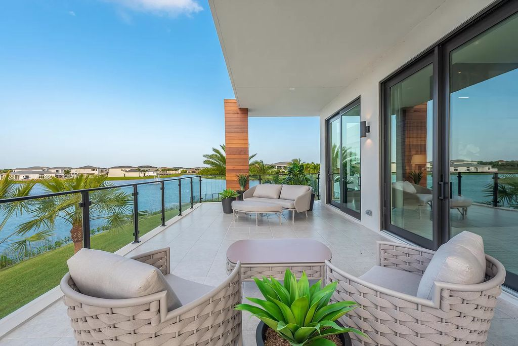 The Home in Boca Raton is a magnificent Modern estate featuring flat roof, floor to ceiling glass and extraordinary Ipey wood accents now available for sale. This home located at 17224 Brulee Breeze Way, Boca Raton, Florida